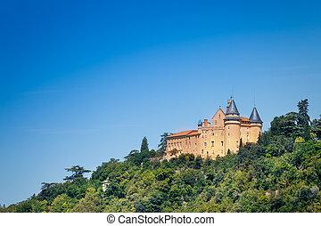 Famous medieval castle of Biron against blue sky