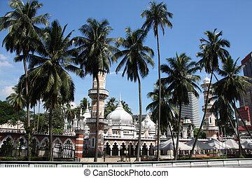 Kuala Lumpur - Famous mosque behind the palms in Kuala...