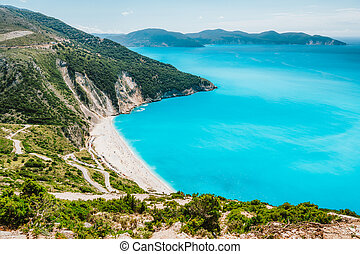 Famous Myrtos Beach. Must see visiting tourism location on Kefalonia island in summer. Greece.