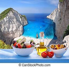 Navagio beach with Greek salad in Zakynthos, Greece - Famous...