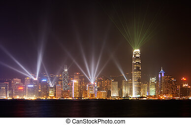 Famous night scenes of rays show on Victoria Harbor in Hong Kong.