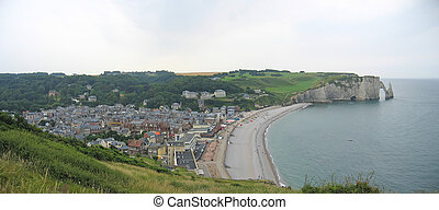 Famous norman city with nice cliffs of limestone falling into the atlantic sea, Etretat, Normandy, France, Panorama