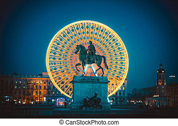 Famous Place Bellecour statue of King Louis XIV by night, Lyon France