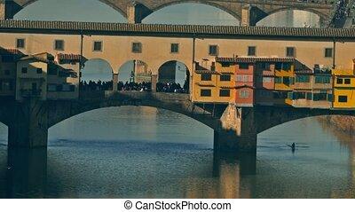 Famous Ponte Vecchio bridge, a major Italian landmark,...