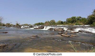 Famous Popa falls on river in Caprivi, North Namibia - Popa...