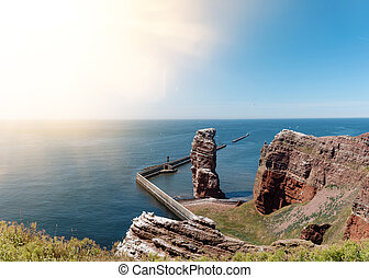 famous sea stack Lange Anna on island of Heligoland against...