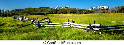 Famous Stanley and Sawtooth log fence in a meadow with mountain range