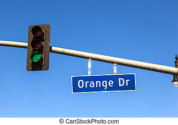 famous street sign orange drive with green traffic light in Hollywood