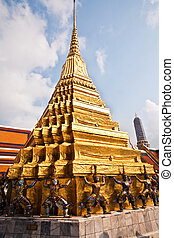 famous temple Phra Sri Ratana Chedi covered with foil gold...