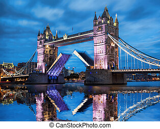 Famous Tower Bridge with open gate in the evening, London, England, UK