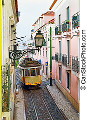 Famous tram line 28 passing a narrow street in Alfama...