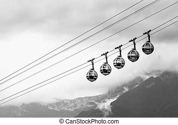 transparent cable cars that links the Bastille with the city center of Grenoble