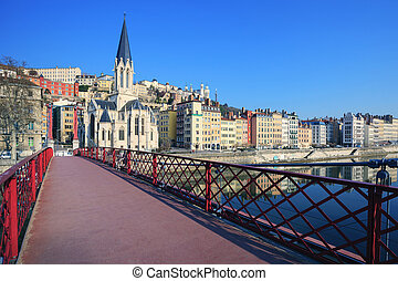 Famous view of Saone river and red footbridge in Lyon city, ...