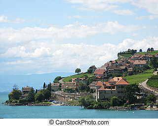Famous vineyards in Lavaux region against Geneva lake....