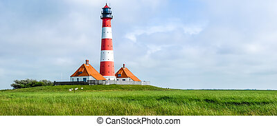 Famous Westerheversand lighthouse at North Sea, Schleswig-...