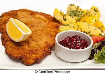 Wiener Schnitzel - Famous Wiener Schnitzel with side dish in...