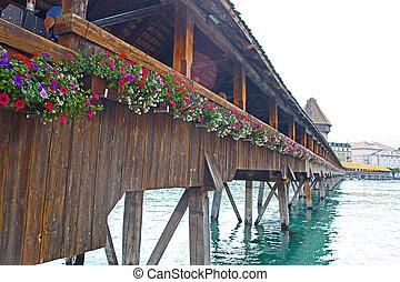 Famous wooden bridge in Lucerne Switzerland.