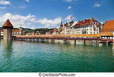 Lucerne, Switzerland - Famous wooden Chapel Bridge in...