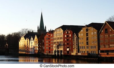Famous wooden colored houses in Trondheim city, Norway,...