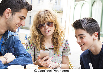 famyly with mobile phone