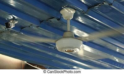 Fan. A ceiling fan cools the room.