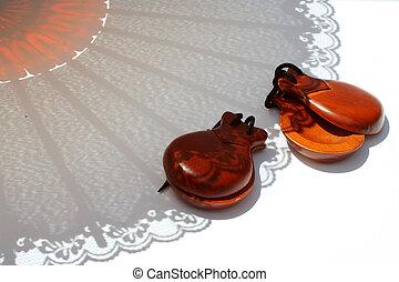 fan shadow - flamenco dancers hand clappers and fan