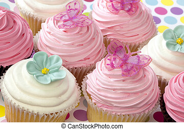Fancy Cupcakes - Lots of fancy cupcakes. Frosted in pink and...