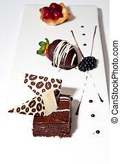 Fancy Custom Deserts on a White Board - Three custom deserts...