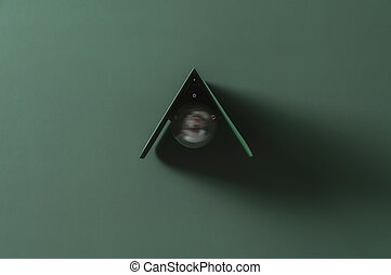 Fancy dark green metal lamp on colorful wall in studio
