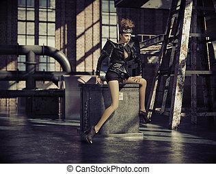 Fancy dressed woman in empty factory
