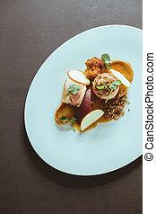 Fancy food on oval plate - Closeup of fancy food on oval...