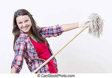 A smiling woman with a washer in her hands