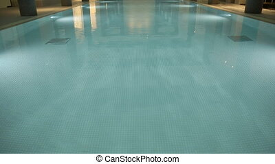 Fancy indoor swimming pool - Tilting up shot of a fancy...