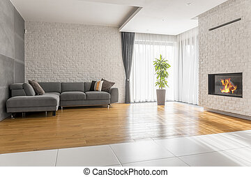 Fancy living room with sofa, fireplace and plant