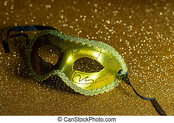 Fancy mask on gold background