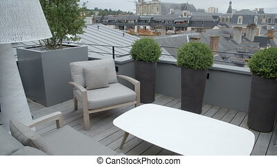 Fancy roof top relaxing lounge - A tilting up shot of a...
