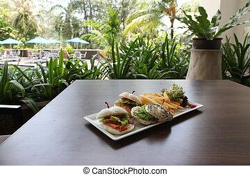 Fancy sandwich bun roll elegant restaurant serving three...