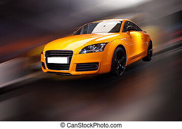 orange fancy sports car in motion with white lable