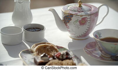 Fancy tea and desserts - Tea and sweets in fancy China sets....