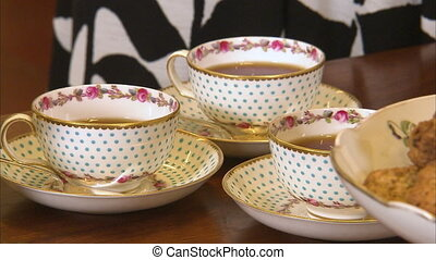 Fancy tea cups and tea - A steady shot of three tea cups in...