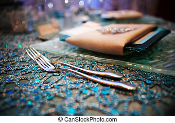 Fancy Wedding Tabletop - Two forks and a plate wrapped up in...