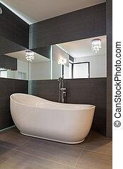 Fancy white bath - White bath in fancy shape in spacious...