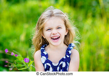 Fanny and beautiful laughing little girl