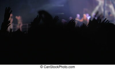 Fans waving hands on concert - Slow motion of people on rock...