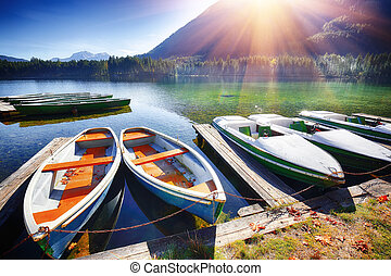 Fantastic autumn day at Hintersee lake. Few boats on the lake