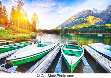 Fantastic autumn evening at Hintersee lake. Few boats on the lake