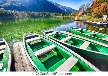Fantastic autumn morning at Hintersee lake. Few boats on the lake