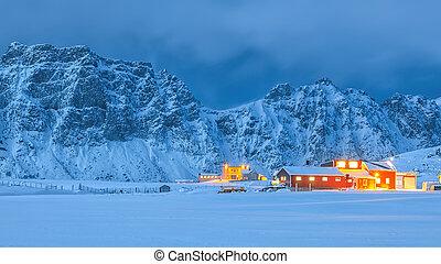 Fantastic evening illumination of traditional Norwagian houses in Utakleiv village on Vestvagoy island.  Location: Utakleiv, Vestvagoy, Lofotens, Norway