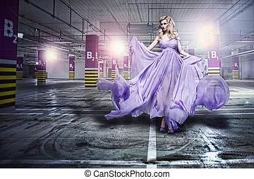 Fantastic fashion woman in fluttering dress