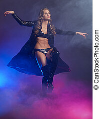 Fantastic female dancer in glow of purple smoke - Fantastic...